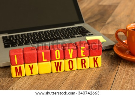 I Love My Work written on a wooden cube in a office desk - stock photo