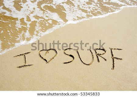 i love surf written on the sand of a beach - stock photo