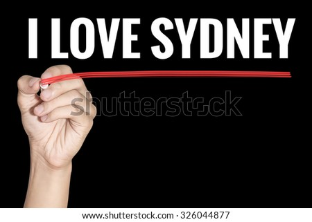 I Love Sydney word writting by men hand holding highlighter pen with line on black background - stock photo