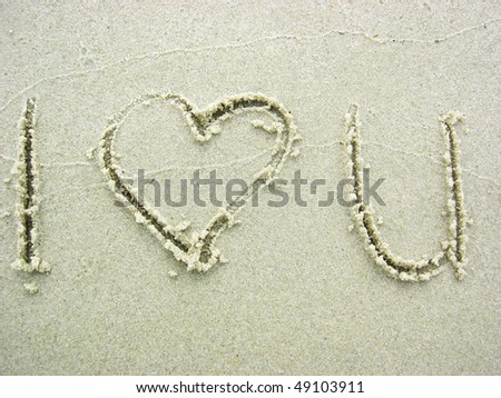 i love u writing on the sand - stock photo