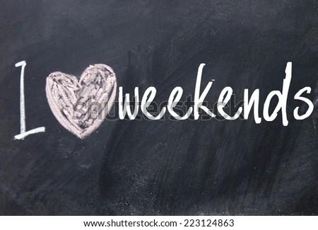 I love weekends text on blackboard - stock photo