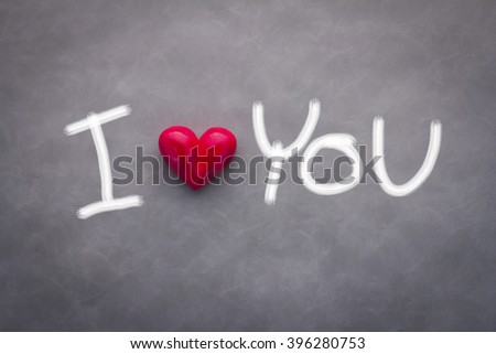 i love you concept with red heart and free hand drawing on grey background - stock photo