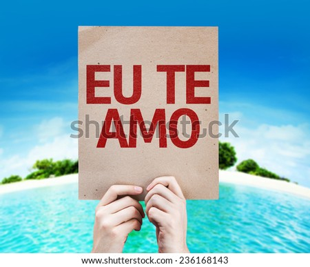 I Love You (In Portuguese) card with a beach on background - stock photo