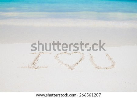 I LOVE YOU letters writing on the sand beach  - stock photo