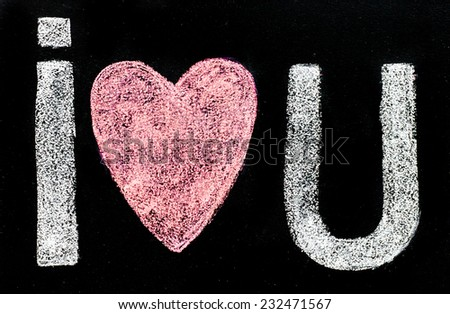 I love you message hand written with chalk on blackboard, word love replaced by heart shape, love concept - stock photo