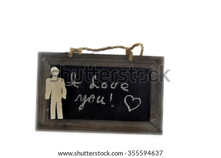 I love you note written on the chalkboard, with a clay man in the foreground - stock photo