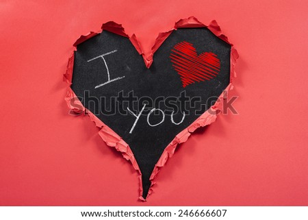 I love you written on blackboard inside of a heart frame - stock photo