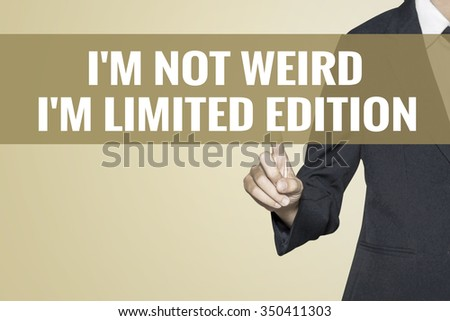 I'm Not Weird Im Limited Edition word on vintage background retro virtual screen touch by business woman on white background - stock photo