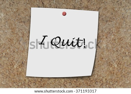 I Quit written on a memo pinned on a cork board - stock photo
