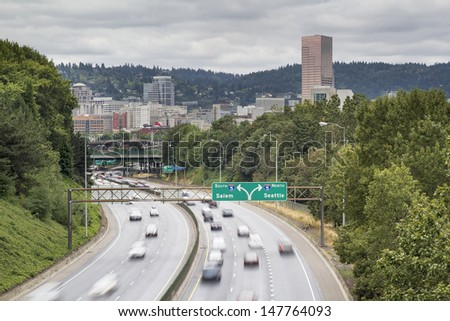 I-84 to I-5 Interstate Freeway in Portland Oregon with Long Exposure Vehicle Traffic Motion - stock photo