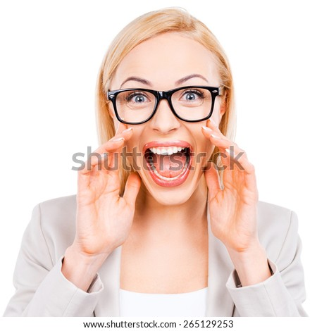 I want everyone to hear me! Cheerful mature businesswoman shouting at camera while standing against white background - stock photo