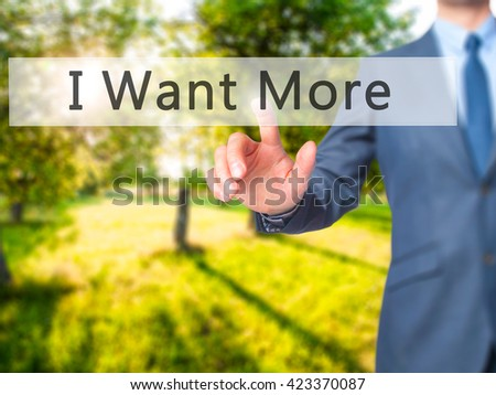 I Want More - Businessman hand pressing button on touch screen interface. Business, technology, internet concept. Stock Photo - stock photo