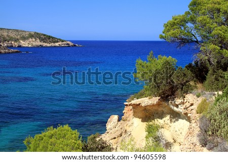 Ibiza island coast with rocks and pine trees - stock photo