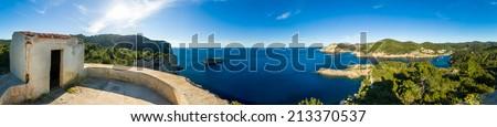 Ibiza island Mediterranean sea landscape with tower - stock photo