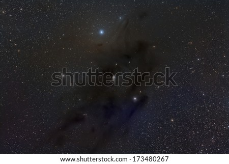 IC 2087 and Barnard 22, a dusty area in Taurus - stock photo