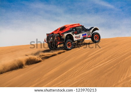 ICA, PERU - JAN. 05: Guerlain Chicherit (FRA) drive his car during his participation on Rally Dakar 2013, JAN 05, 2013 in Ica, Peru. - stock photo