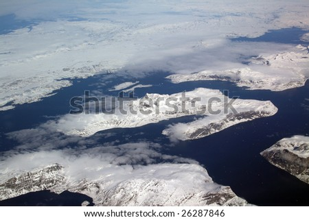 ice and lakes in greenland aerial view - stock photo