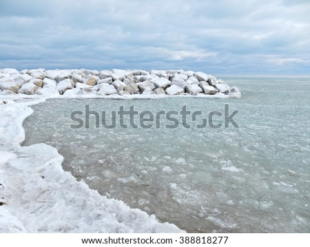 Ice and snow formations along lake Michigan coast - landscape color photo - stock photo