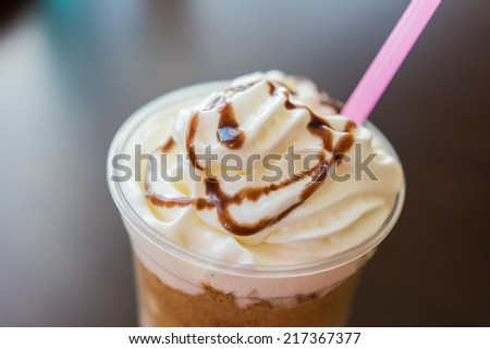 Ice And Whip Cream Frappe Coffee With Chocolate Topping Close Up - stock photo