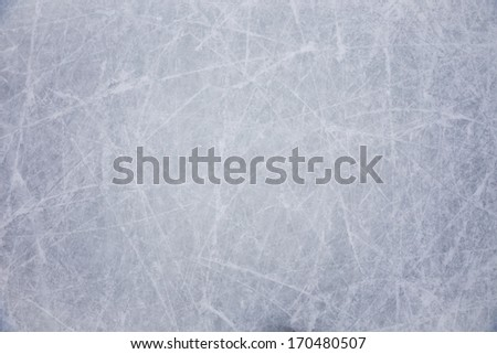 ice background with marks from skating and hockey, blue texture - stock photo