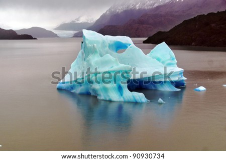 Ice berg, Torres del Paine, Chili is probably the world's most spectacular national park. An unrivalled landscape of mad jagged peaks, impossibly blue lakes, deserted pampas and iceberg-loaded river - stock photo
