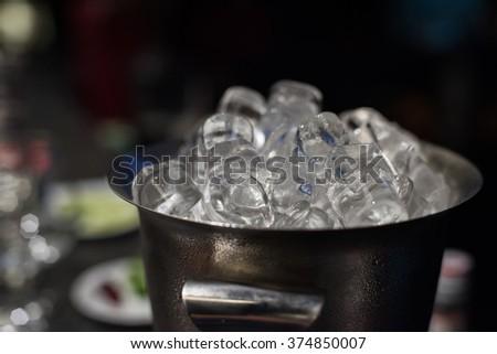 Ice bucket with ice cubes - stock photo