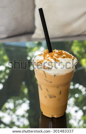 Ice caramel coffee with whipped cream in take a way cup - stock photo