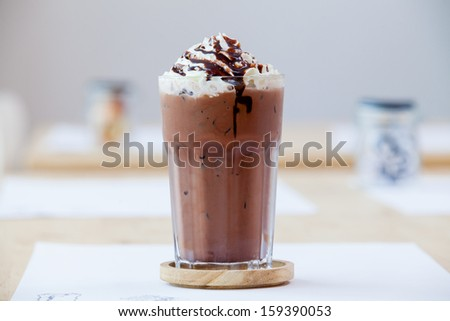 Ice chocolate with whipped cream on table - stock photo