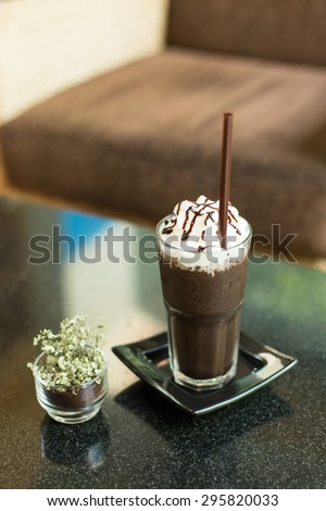 Ice chocolate with whipped cream on table. - stock photo