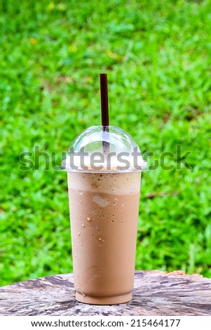 ice  coffee and caramel smoothie on old wooden - stock photo