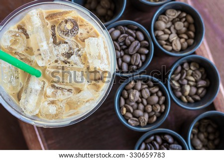 Ice coffee and Coffee beans - stock photo