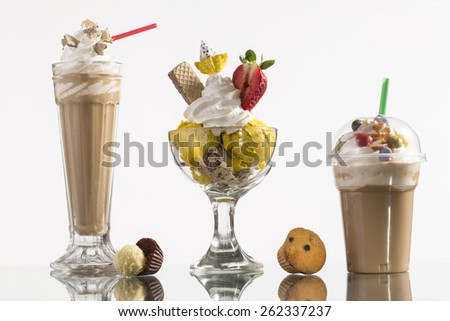 ice coffee and ice coffee take-away, and Neapolitan cup with vanilla ice and whipping cream decorated for menu card - stock photo