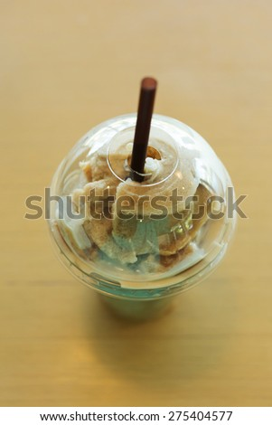ice coffee frappe served on wooden table - stock photo