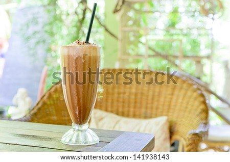 Ice Coffee on the wooden table - stock photo