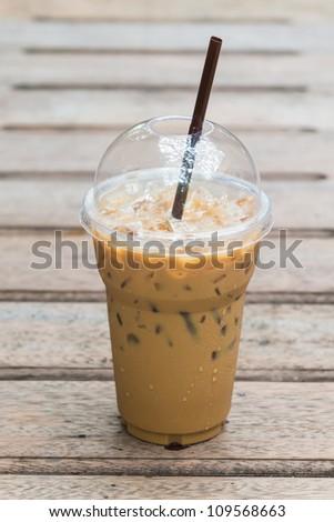 Ice coffee on wood table - stock photo