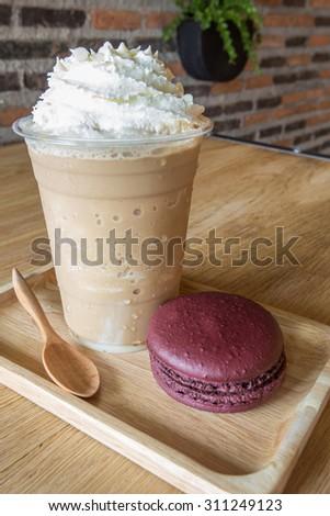 ice coffee serve with macaroon - stock photo