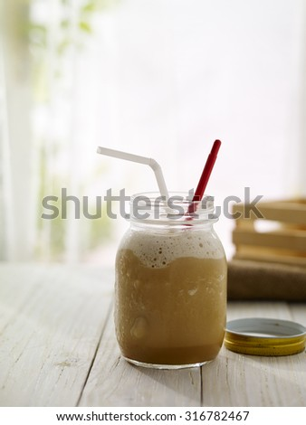 Ice coffee with window background - stock photo