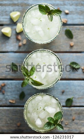 Ice cold beverage with lime and mint - stock photo