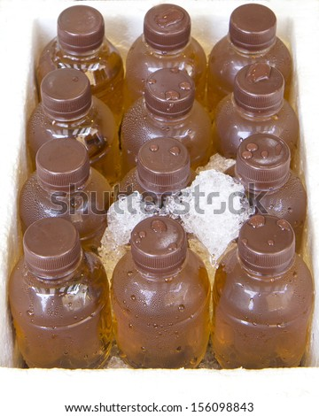 Ice Cold Juice in bottles . - stock photo