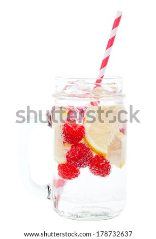 Ice cold sparkling water over ripe fresh fruit make for a healthy and thirst quenching beverage on a hot summer day.  Includes clipping path. - stock photo