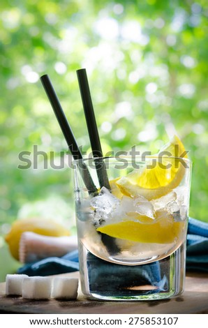 Ice Cold Summer Spirit Refreshment with Lemon - stock photo