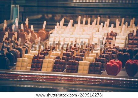 Ice cream chocolate bars in a shop. Toned image. Shallow DOF - stock photo