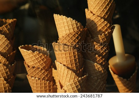 Ice cream cones in the window of an ice cream shop. - stock photo