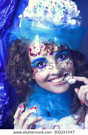 Ice cream girl. Portrait of young woman in creative image. - stock photo