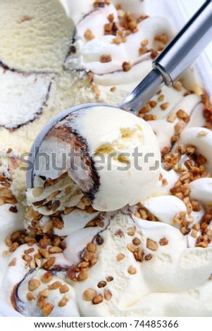 Ice cream   Ice cream scooped out of container - stock photo