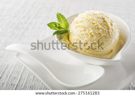 Ice cream in bowl on white background - stock photo