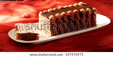 Ice cream on a plate with chocolate topping - stock photo