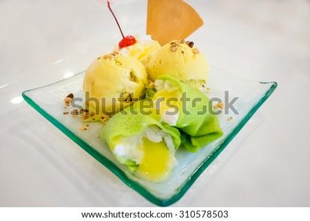 Ice cream on white table. - stock photo