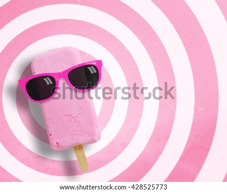 Ice cream stick wearing sunglasses on circle pattern pink and white background with copy space.,Pastel tone. - stock photo