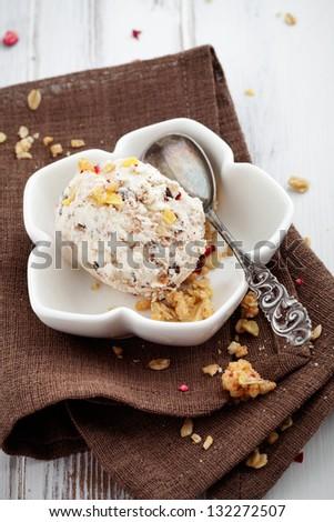 Ice cream with dried fruits and muesli - stock photo